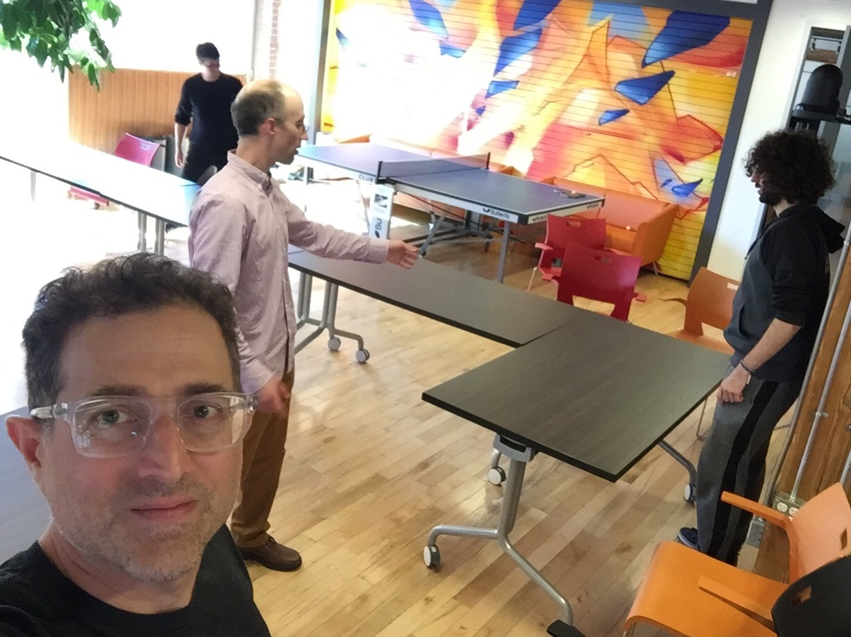 Cameron, David Baron, Emilio, and Tantek arranging actual physical tables in the main meeting room at Mozilla Toronto